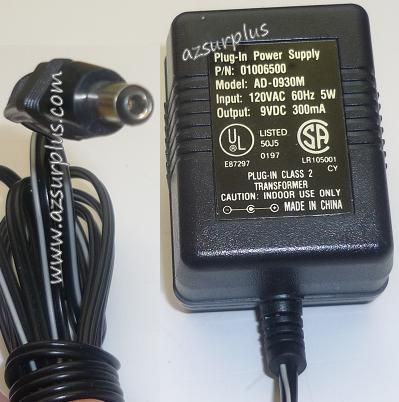 AD-0930M AC ADAPTER 9VDC 300mA USED -(+) 2.5x5.5x9.6mm ROUND BAR