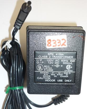 41-12-300 D AC ADAPTER 12VDC 300mA USED -(+) 1x3.5mm ROUND BARRE