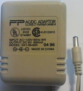 FP D35-6-500 AC ADAPTER 6Vdc 500mA USED 2 x 5.4 x 12.2 mm